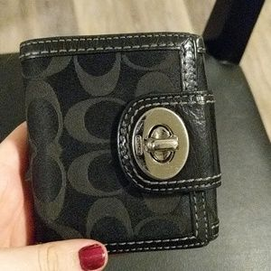 Black and pink coach wallet